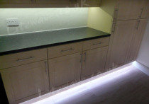 RGB LED Tape set to show white light under kitchen cabinets
